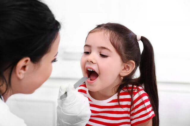 Examining Child's Throat